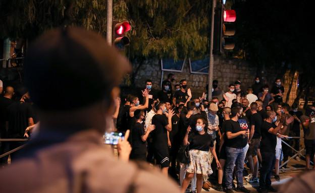 לה פמיליה בהפגנה (צילום: פלאש 90)