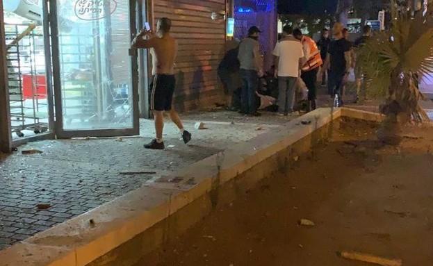 פגיעה במרכז מסחרי באשדוד - יירוט רקטות (צילום: אנשי הדממה)