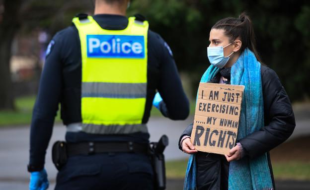 הפגנה במלבורן אוסטרליה נגד הגבלות הקורונה (צילום: Erik Anderson, רויטרס)
