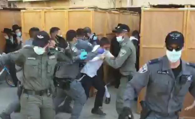 עימותים בין המשטרה לחסידים באשדוד (צילום: מוטי זילברברג)