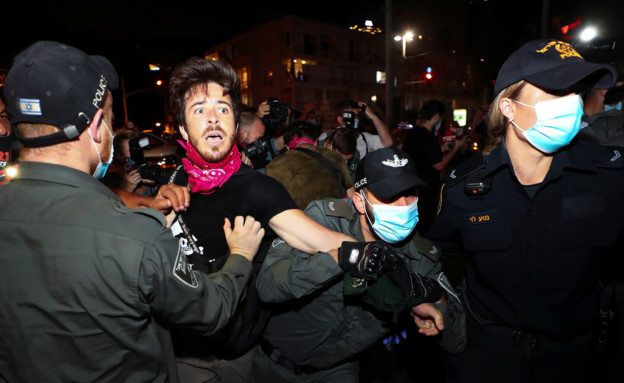 עימותים בהפגנה בתל אביב (צילום: רויטרס)