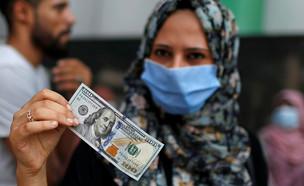 הכסף הקטרי שמוזרם לרצועת עזה (צילום: רויטרס)