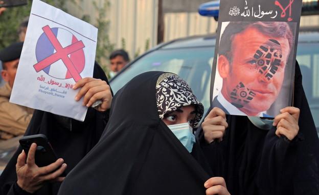 מפגינים בעיראק נגד עמנואל מקרון (צילום: Teba Sadiq, רויטרס)