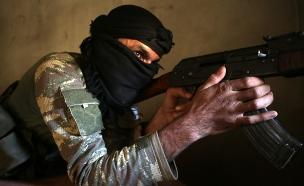 לוחם מיליציות בסוריה (צילום: BAKR ALKASEM/AFP via Getty Images)