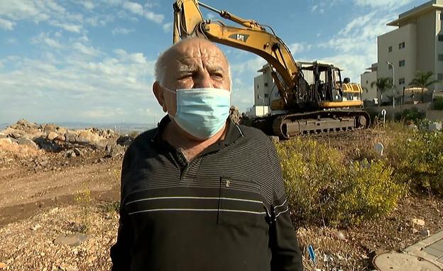 אברהם שושני, קבלן עבודות עפר מאוים בחצור הגלילית (צילום: החדשות 12)