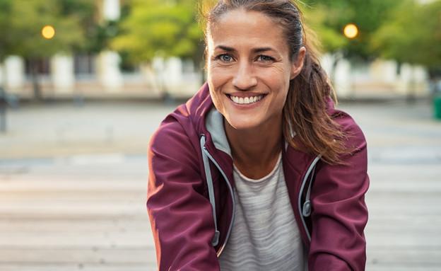 אישה אחרי אימון, בת 40 (צילום: Rido, Suttrstock)