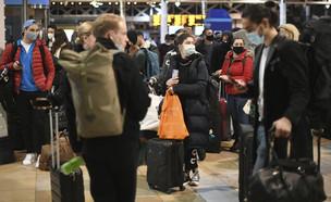 תחנת הרכבת העמוסה בפדינגטון בלונדון בסוף השבוע (צילום: Stefan Rousseau, AP)