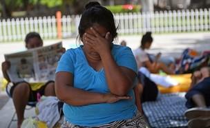 אישה מקסיקנית (צילום:  PEDRO PARDO/AFP via Getty Images)