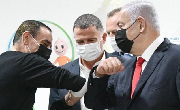 """ראש הממשלה נתניהו עם המתחסן המיליון באום אל פחם (צילום: חיים צח, לע""""מ)"""