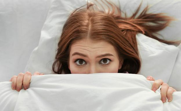 אישה במיטה  (צילום:  Africa Studio, shutterstock)