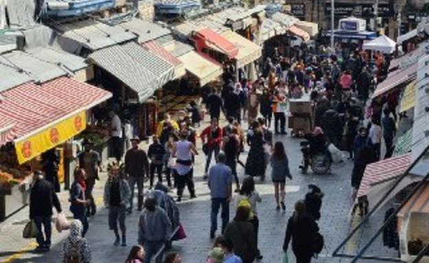 שוק מחנה יהודה בזמן הגבלות פורים בירושלים (צילום: N12)