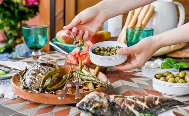 ארוחת דגים (צילום: Marina Bakush, Shutterstock)