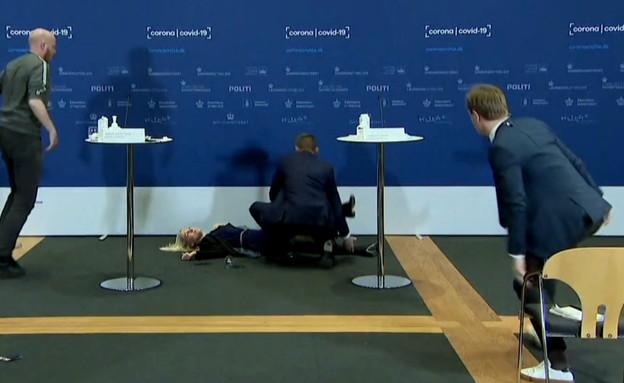 """יו""""ר סוכנות התרופות של דנמרק מתעלפת במסע""""ת (צילום: BBC)"""
