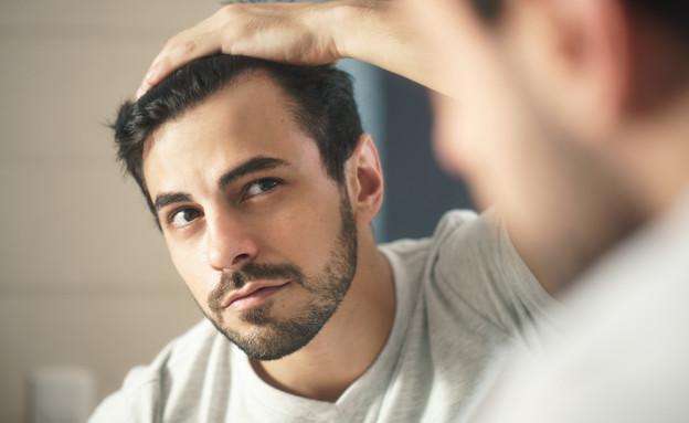 השתלת שיער (צילום: shutterstock By Diego Cervo)
