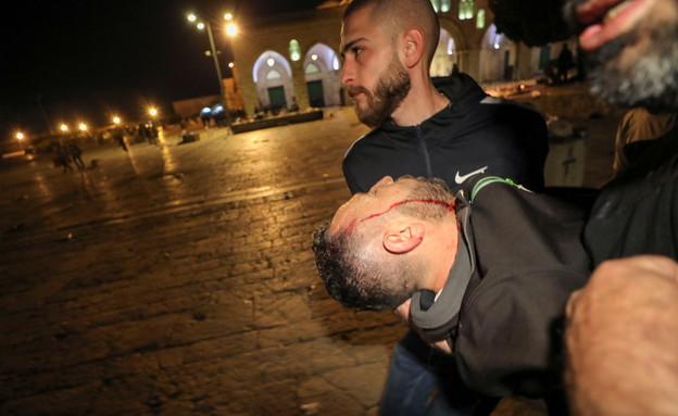 פצוע כתוצאה מהתנגשויות בין מתפללים ושוטרים (צילום: רויטרס, שי פרנקו,רויטרס)