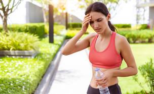כאב ראש אחרי ריצה (צילום:  Nutlegal Photographer, shutterstock)