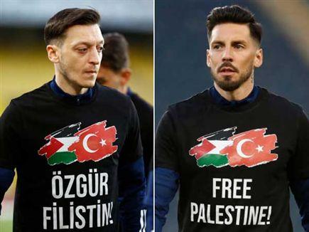 """חולצות החימום של פנר: """"שחררו את פלסטין"""""""