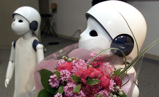 """""""נערת פרחים"""" רובוטית (צילום: רויטרס)"""