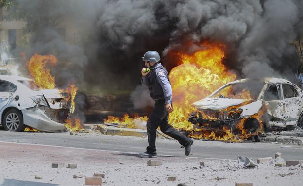 מהומות בערים המעורבות (צילום: AP)