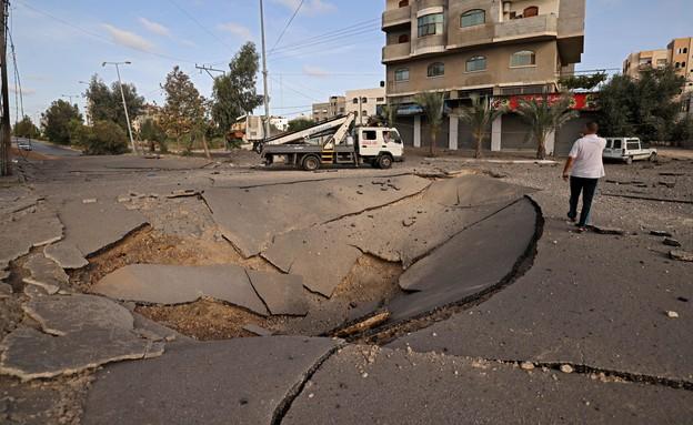"""הפצצת המטרו של עזה על ידי צה""""ל (צילום:  MOHAMMED ABED, AFP)"""