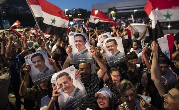 חגיגות בסוריה: הנשיא אסד ניצח בבחירות (צילום: AP)