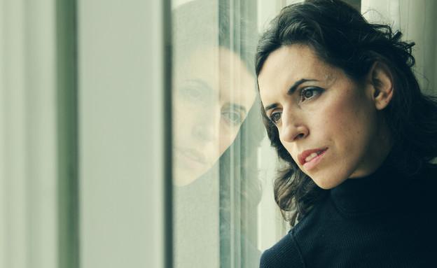אישה עצובה (צילום: Dubova, shutterstock)