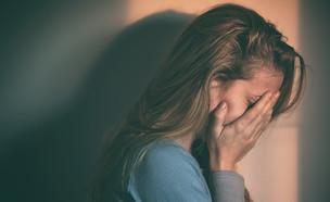 צעירה עצובה (אילוסטרציה:  Marjan Apostolovic, shutterstock)