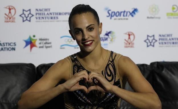 לינוי אשרם זכתה במדליית זהב בקרב רב בגראנד פרי תל  (צילום: איגוד ההתעמלות)