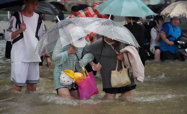 הצפות ושטפונות בסין (צילום: רויטרס)