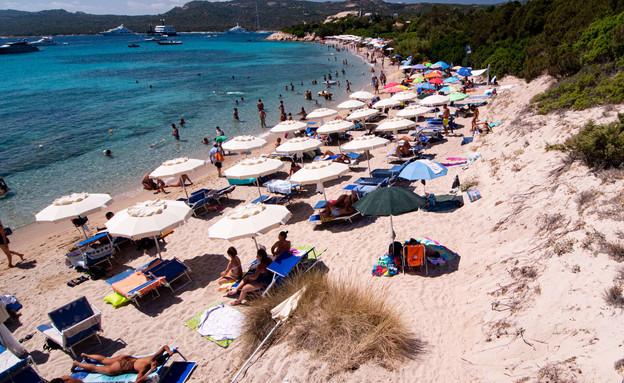 חוף בסרדיניה, בצל מגפת הקורונה (צילום:  Emanuele Perrone, getty images)