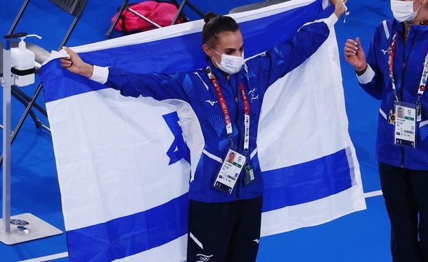 לינוי אשרם טוקיו 2020 דגל ישראל (צילום: רויטרס)