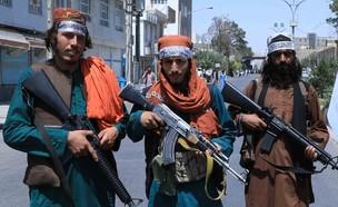 כוחות טליבאן חמושים באפגניסטן (צילום: AREF KARIMI/AFP, GettyImages)
