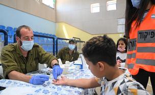 מתחם בדיקות סרולוגיות של נוגדנים בילדים בגילאי 3 עד 12 במרכז קצרין (צילום: מיכאל גלעדי, פלאש 90)