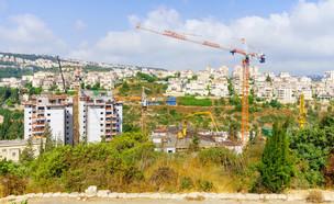 אתר בנייה בשכונת נווה שאנן בחיפה (צילום:  RnDmS, shutterstock)